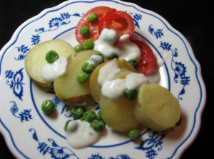 A simple salad of boiled potatoes, tomatoes and peas drizzled with buttermilk dressing