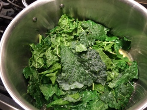 kale and chard leaves beginning to simmer